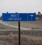 Image of the road sign for Mike's Antiques